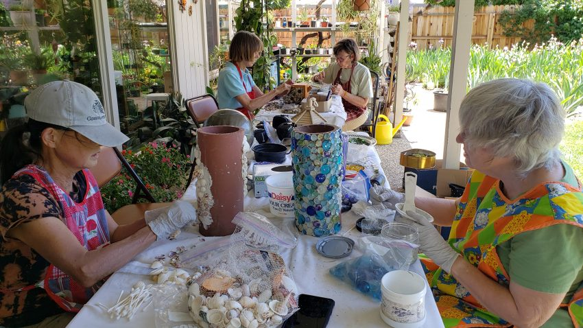 Members concentrate on mosaic projects
